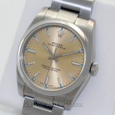 Rolex Oyster Perpetual 114200 Steel Champagne Dial