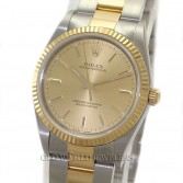 Rolex Oyster Perpetual 14233 18K Gold Steel Champagne Dial